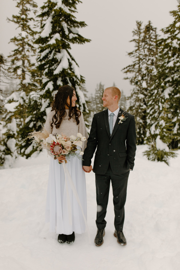 Couple holding hands on Mount Baker elopement