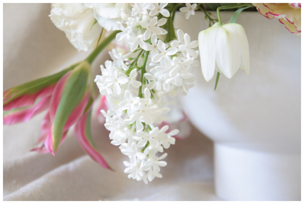 white lilac in a wedding centerpiece alongside white fritillaria