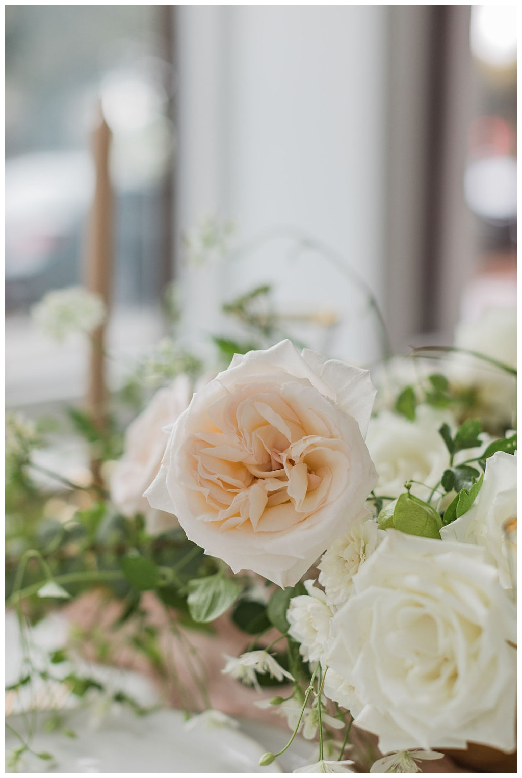 a blush colored garden rose in a wedding centerpiece for an indoor Seattle wedding