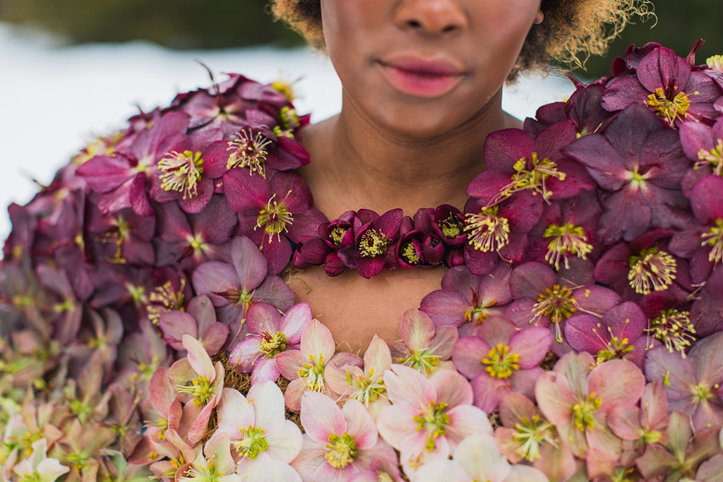 a neckline cutout of red hellebores on the couture dress