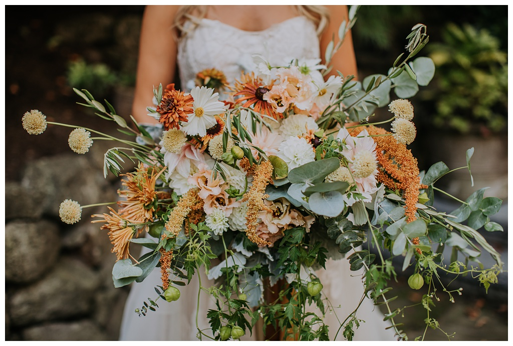 the bride holding her boho bouquet at a Seattle outdoor wedding
