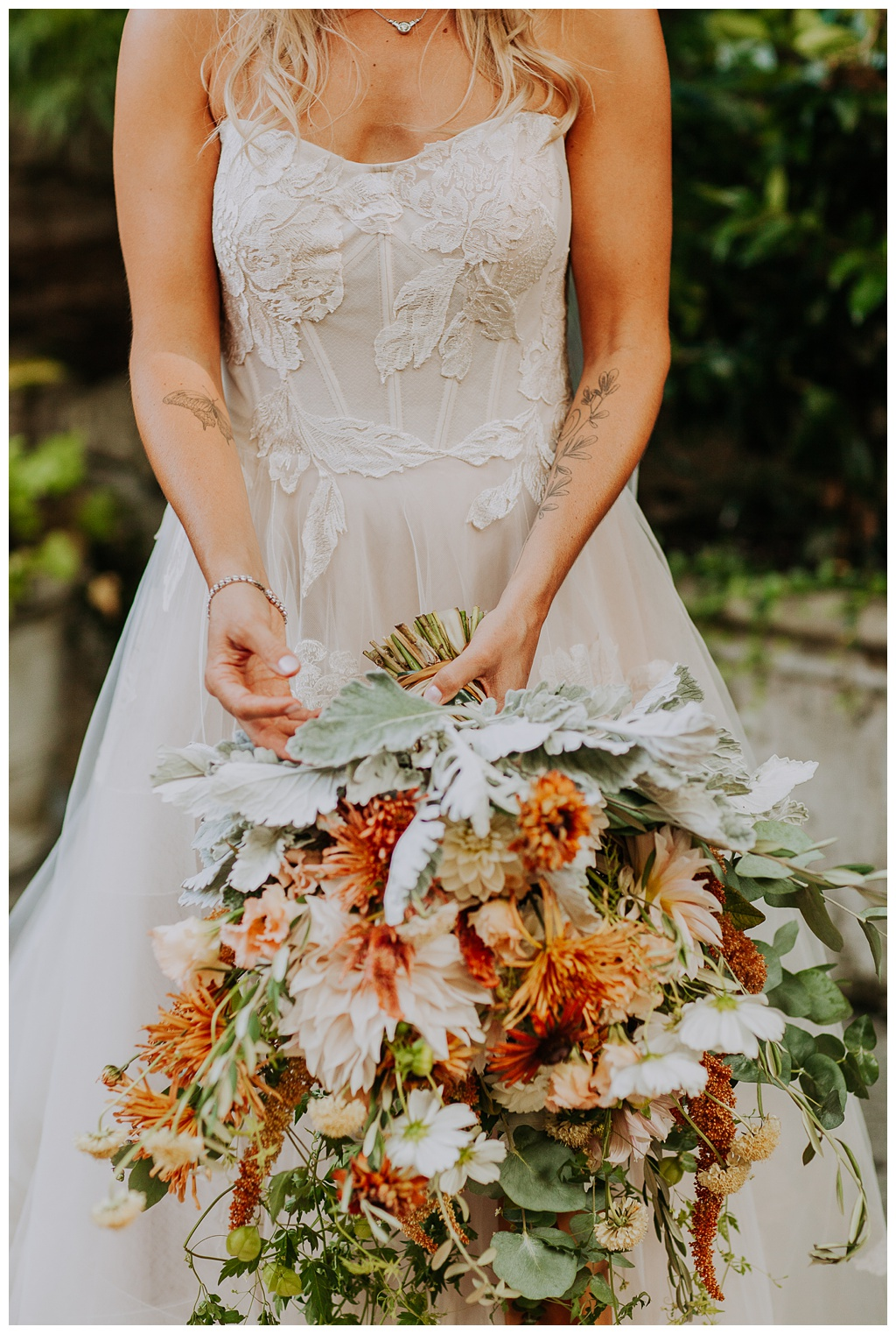 the bride holding her bridal bouquet, made of local and seasonal boho wedding flowers