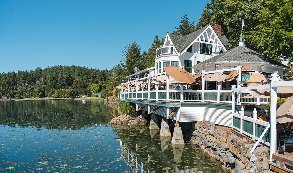 An image of Roche Harbor Resort perched on the edge of the water