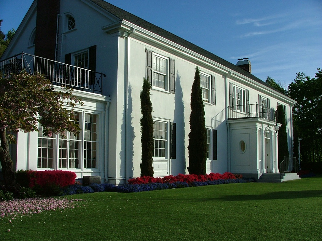 The Admiral's House, on a clear blue sky day with beautifully manicured lawn and gardens
