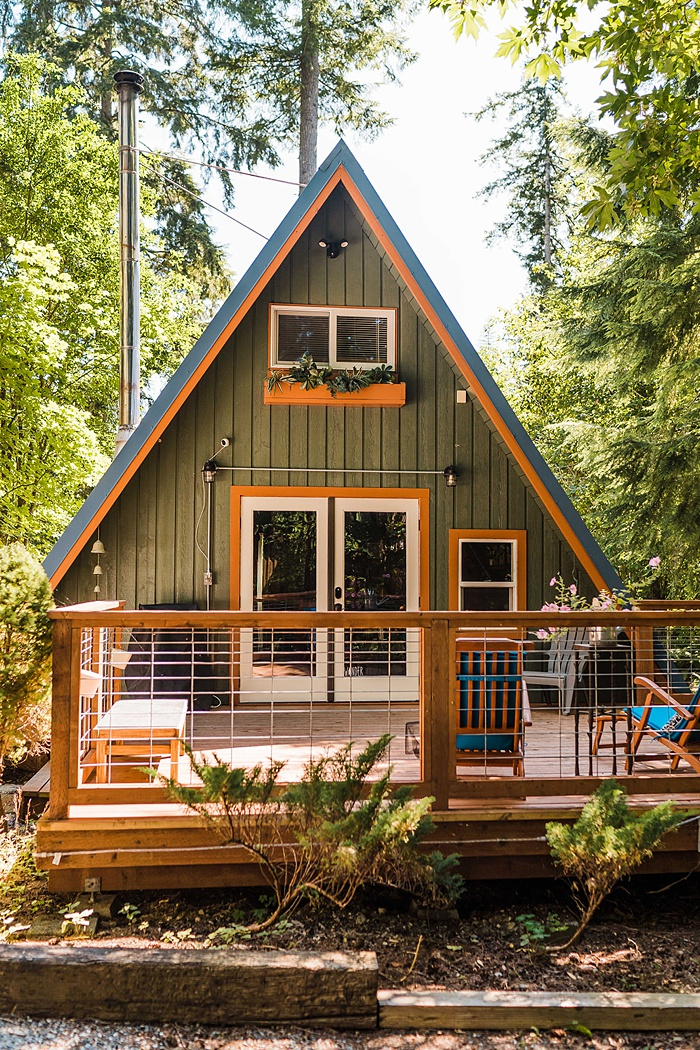 a beautiful A-frame cabin in the woods