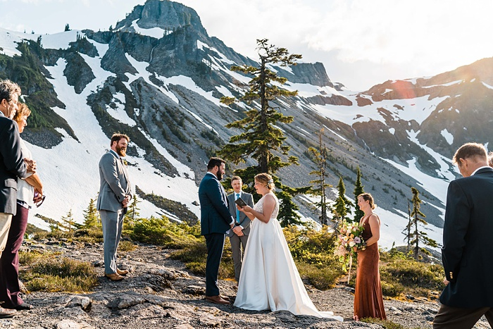 a mountain wedding ceremony with family and friends gathered