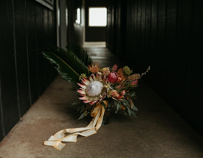 a tropical flower bouquet sits in the hallway