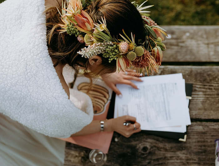 the bride signs the marraige paperwork