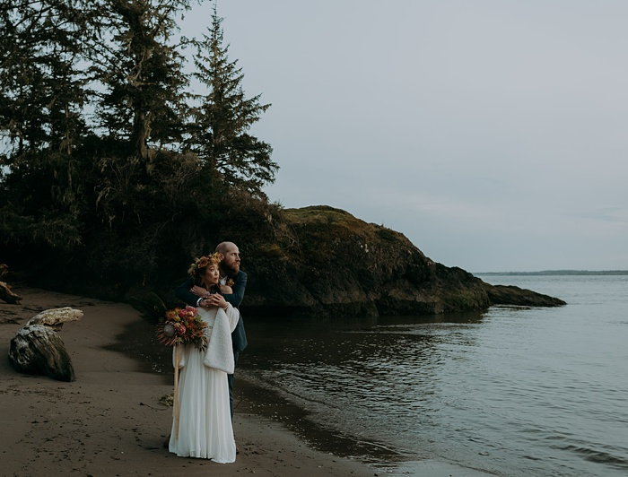 a couple holds each other after being married