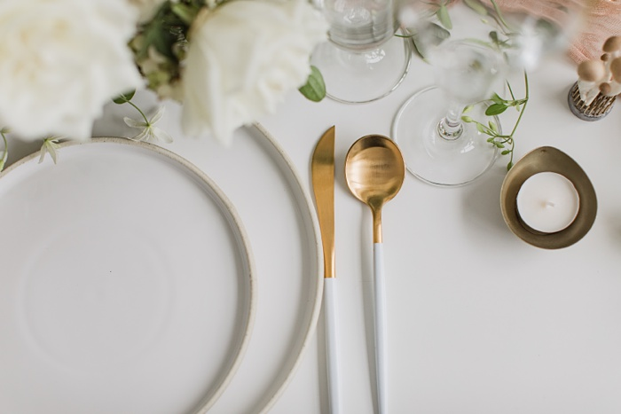 white stone plates with table settings