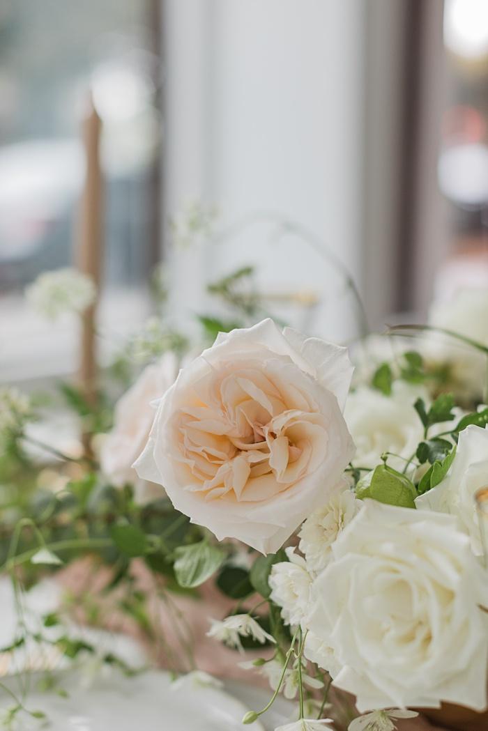 a garden rose in the table arrangement