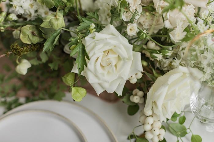 white wedding flowers above stoneware plates