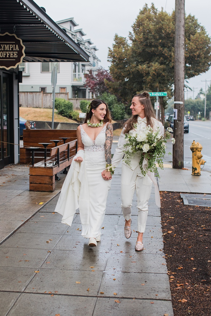 two brides talking down the street