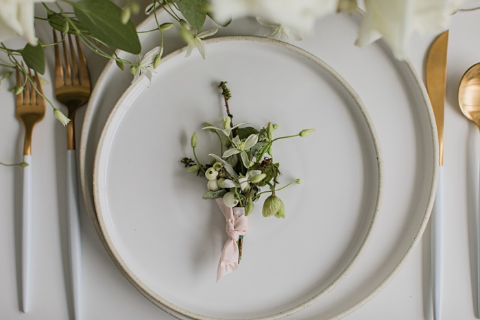 the boutonniere resting on a plate